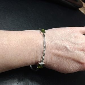 Silver tone bangle with stones